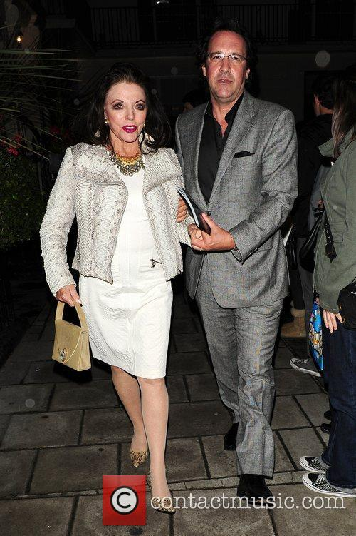 Joan Collins and Percy Gibson leaving the Theatre...