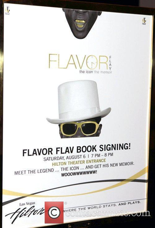 Atmosphere Flavor Flav signs copies of his new...