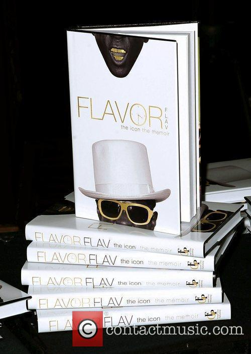 Flavor Flav signs copies of his new book...