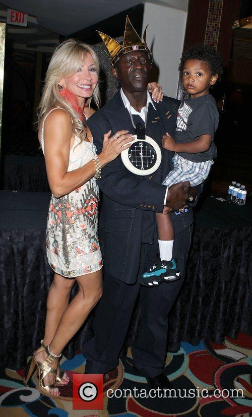 Flavor Flav with his fiancee Liz and their...