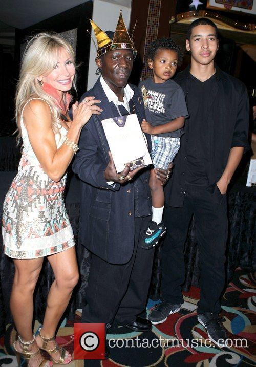 Suzette Snider, Flavor Flav with his son Karma...