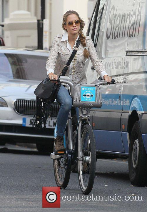 Rides a hired bicycle in central London