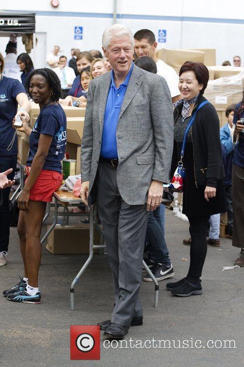 Bill Clinton volunteering at the San Diego food...