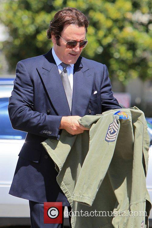 Frank Stallone seen trying on an army jacket...