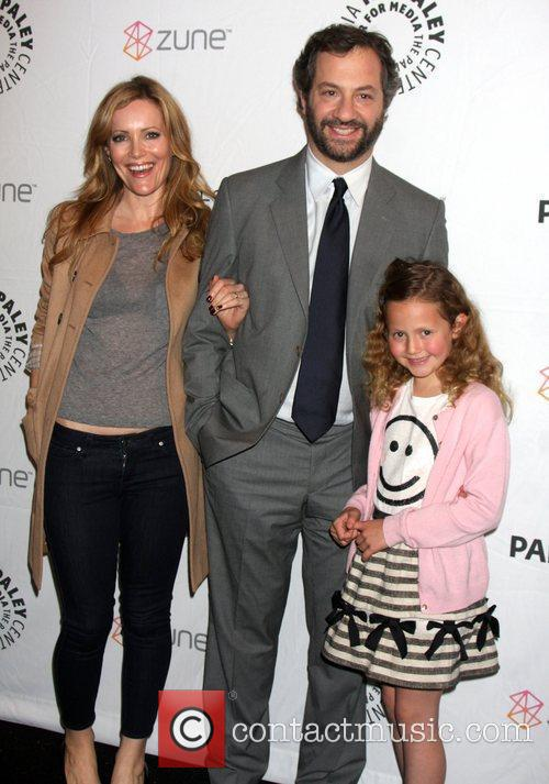 Leslie Mann and Judd Apatow with their daughter...