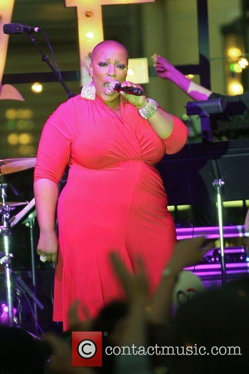 Frenchie Davis of TV show, The Voice performing...