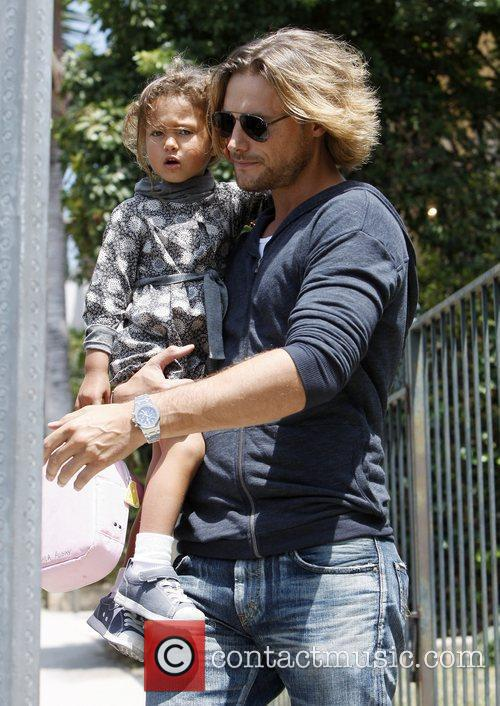 Gabriel Aubry picks up his daughter, Nahla Aubry,...