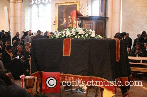 The funeral of the former British boxing champion...