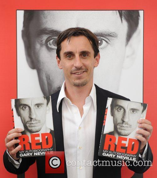 Signs copies of his autobiography 'Red' at Waterstones,...