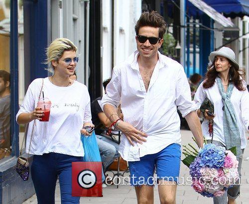 Nick Grimshaw and Pixie Geldof walking in Primrose...