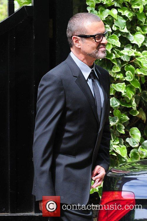 George Michael leaving home to go to a...