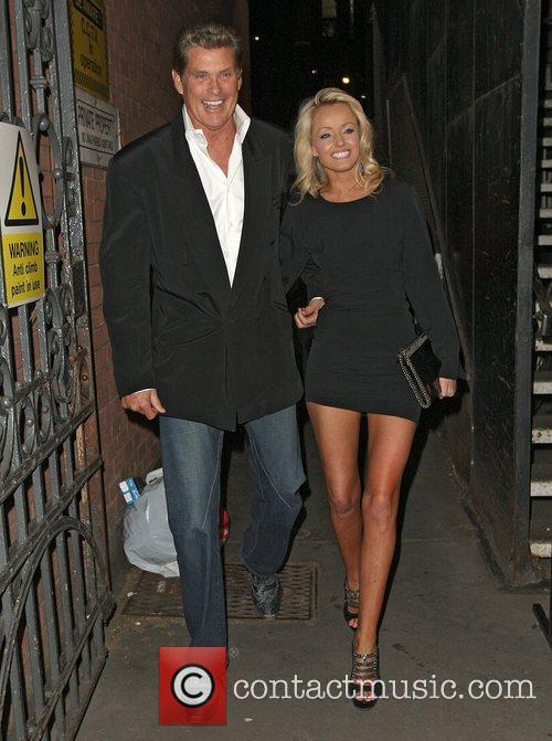 David Hasslehoff being squeezed by girlfriend Hayley Roberts...