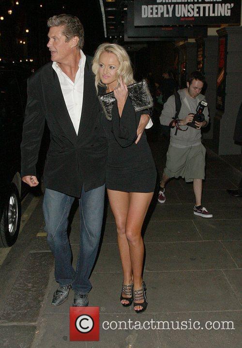 David Hasslehoff being squeezed by girlfriend Hayley Roberts...