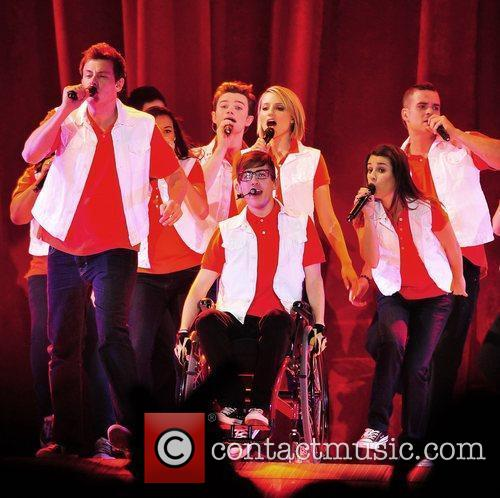 The cast of Glee Live! In Concert! Performing...