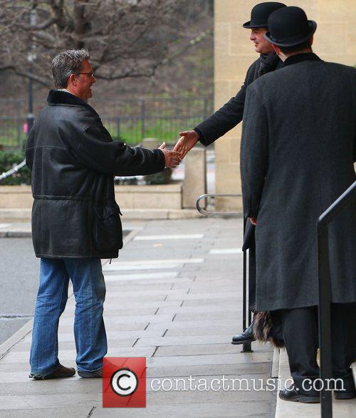 Kurt Russell shakes hands with the doorman as...