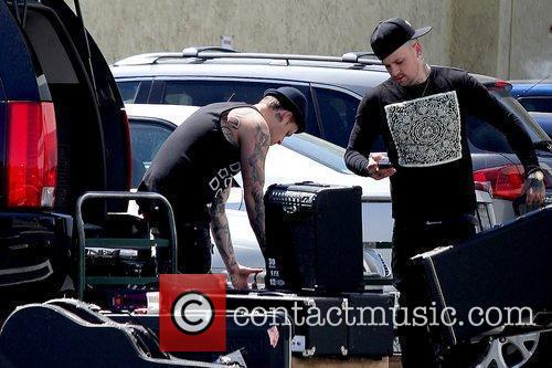 Joel Madden and Benji Madden picking up their...