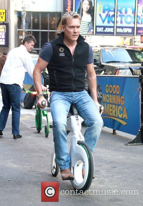 Sam Champion taking a ride on the 'Yike...