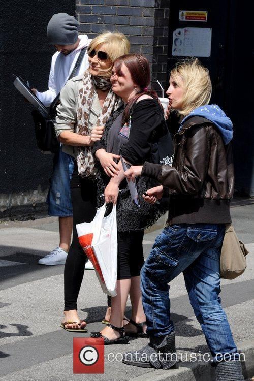 Michelle Collins posing with fans Michelle Collins outside...