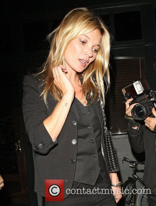 Kate Moss leaving the Groucho Club in Soho...