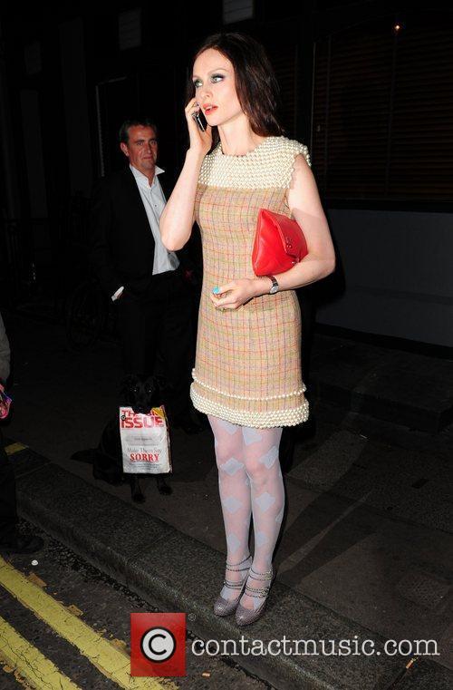 Sophie Ellis-Bextor talking on her mobile phone outside...