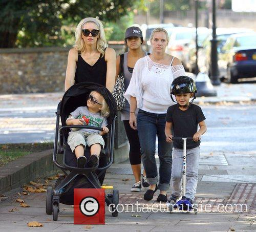 Walking in north London with her sons Kingston...