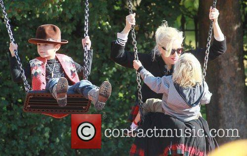 Gwen Stefani  plays on the swings with...