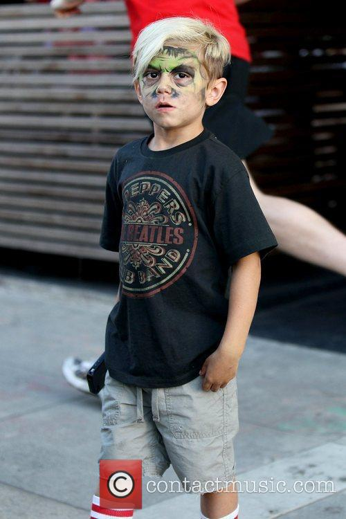 Kingston Rossdale with his face painted, as he...