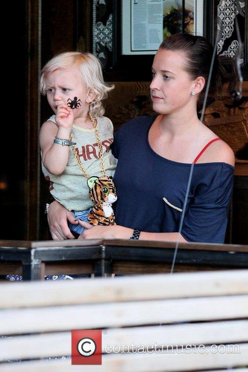 Zuma Rossdale being held by his nanny at...