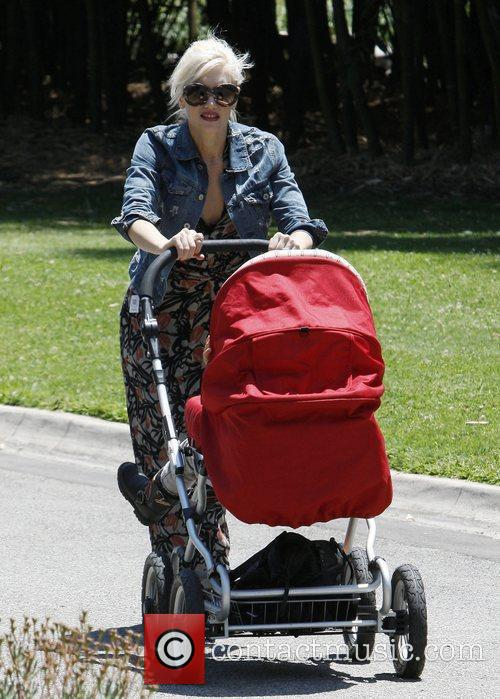 Pushing her stroller as she takes her sons...