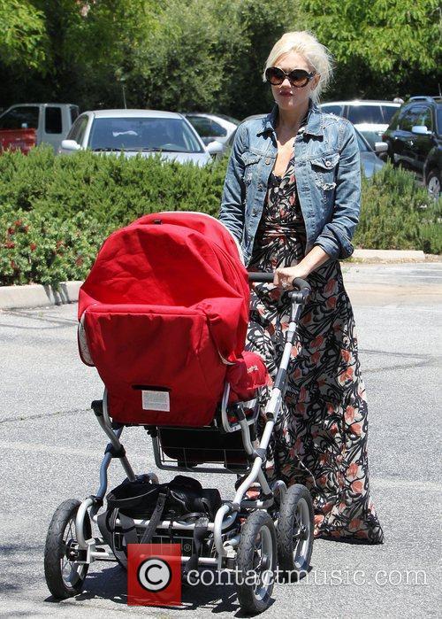 Gwen Stefani pushing her stroller as she takes...