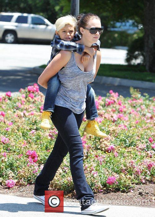 Gets a piggy-back ride from his nanny, as...