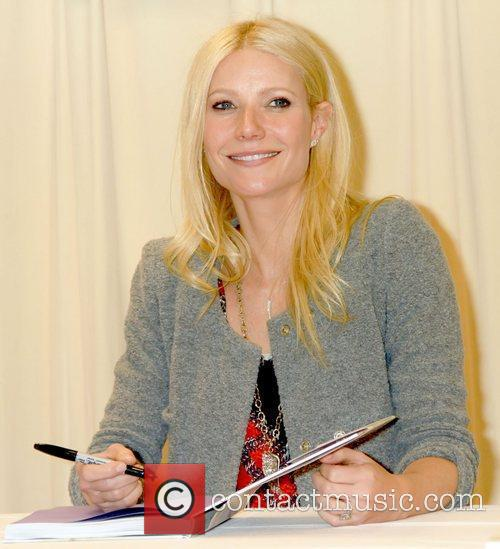 Gwyneth Paltrow signs copies of her new cookbook...
