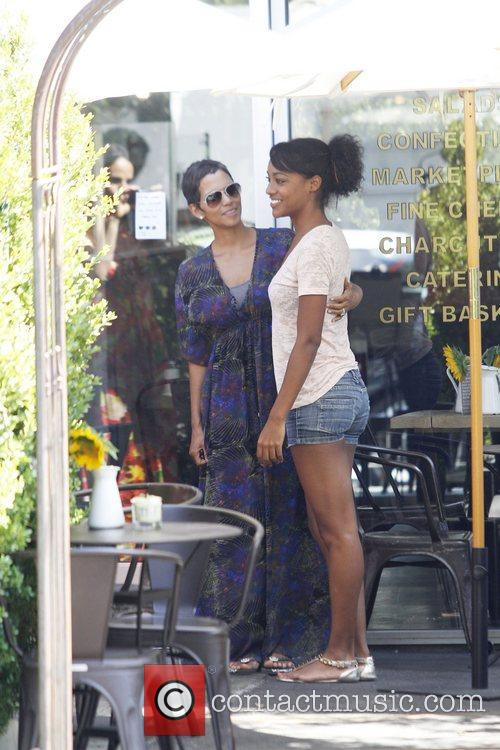 Halle Berry chats with a fan as she...