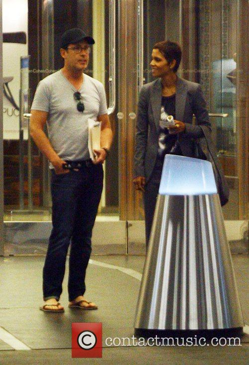Halle Berry chatting to a friend outside an...