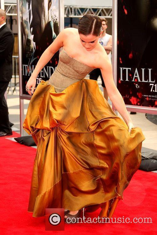 Emma Watson adjusting her dress New York premiere...