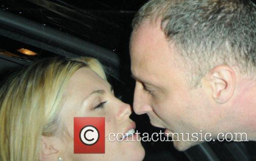 Abbey Clancy leaves Harry's Bar with a male...