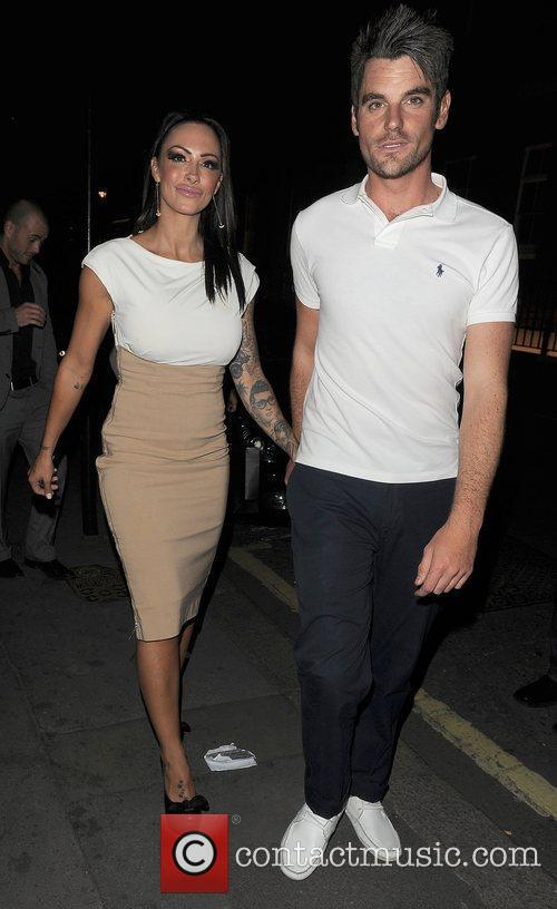 Jodie Marsh and a male companion out and...