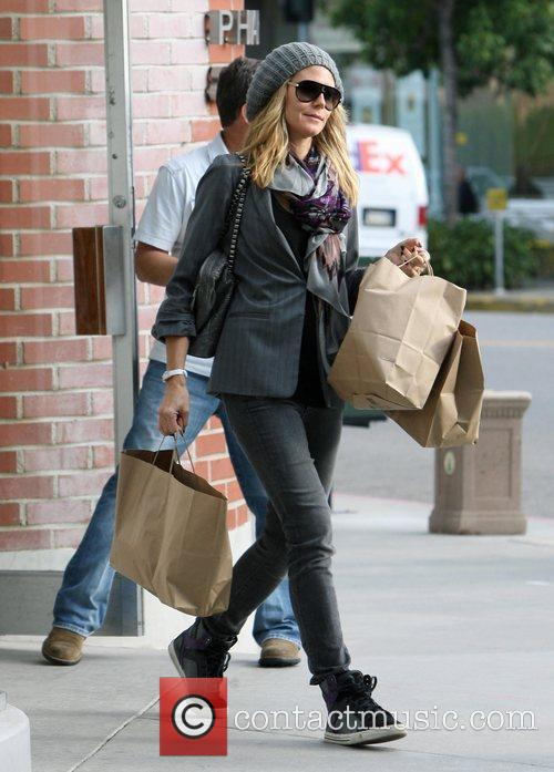 Heidi Klum shopping with her mother and daughters...