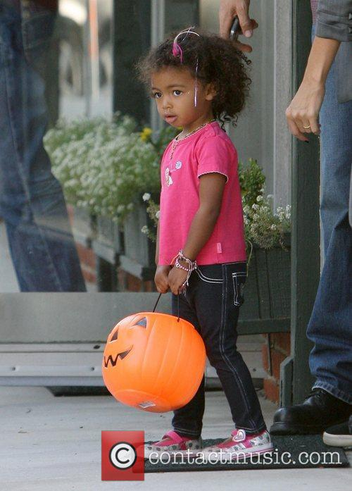 Lou Samuel shopping with her family in Brentwood...