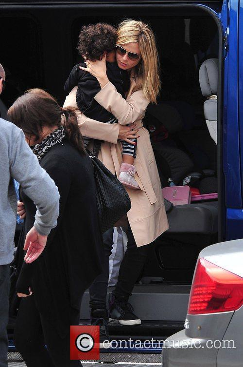 Heidi Klum carrying son Johan Samuel  while...