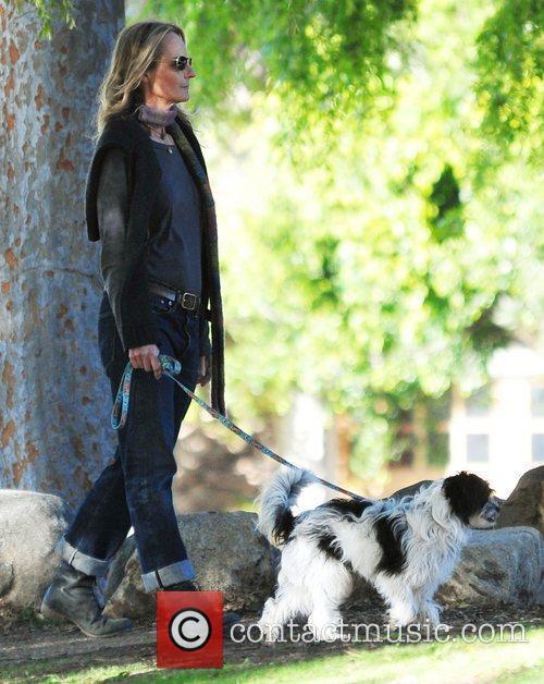 Helen Hunt walks her dog in the park...
