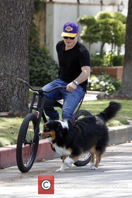 Takes a bike ride with his wife and...