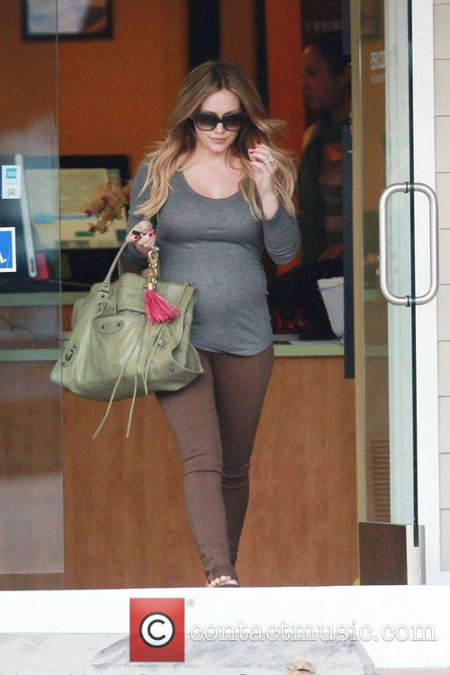 Pregnant Hilary Duff shows off her big belly...