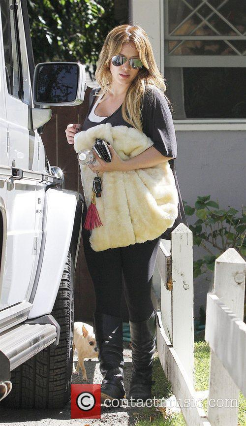 Hilary Duff gets into a Mercedes-Benz SUV outside...