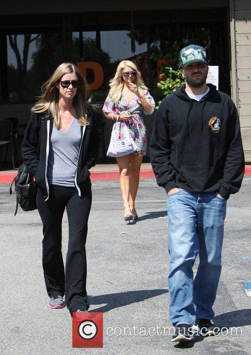 Paris Hilton, Nicky Hilton and David Katzenberg spend...