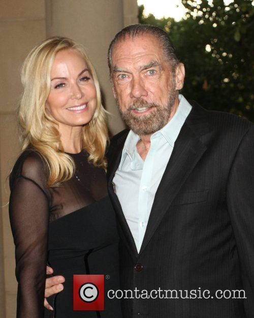 John Paul DeJoria (R) with wife Eloise 13th...
