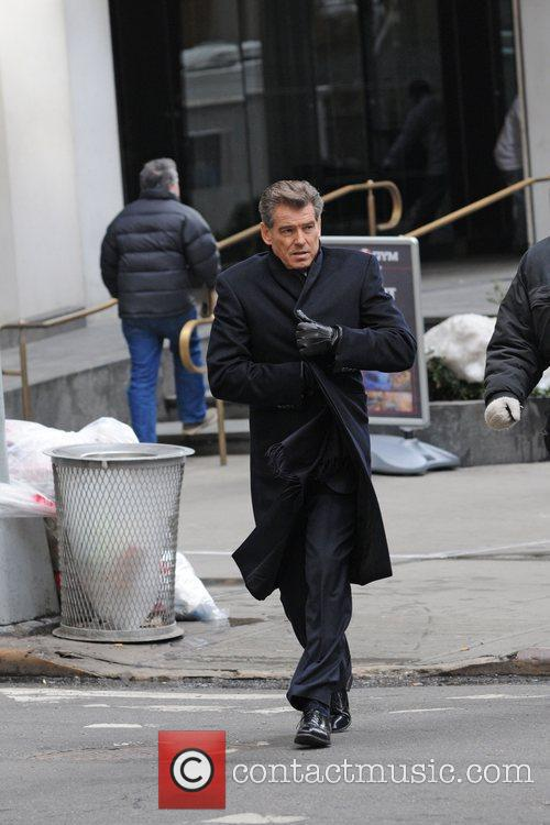 Pierce Brosnan filming on the set of her...