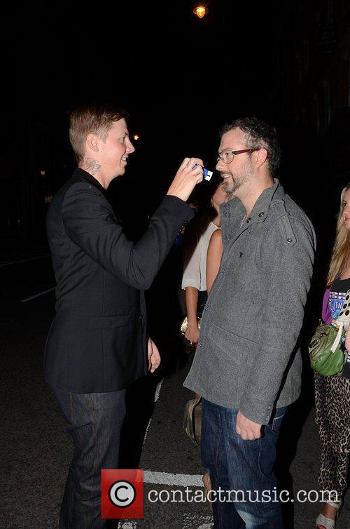 Professor Green stamping the Hoxton Pony logo on...