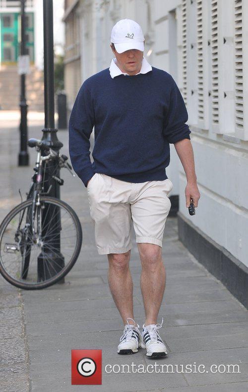 Hugh Grant outside his house London, England