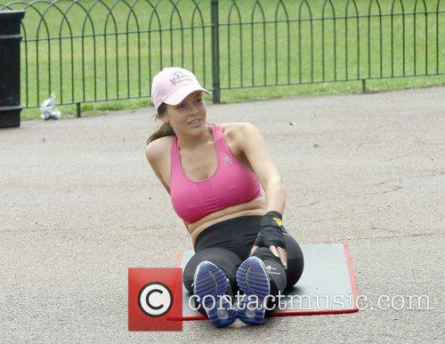 Imogen Thomas works out in a park with...